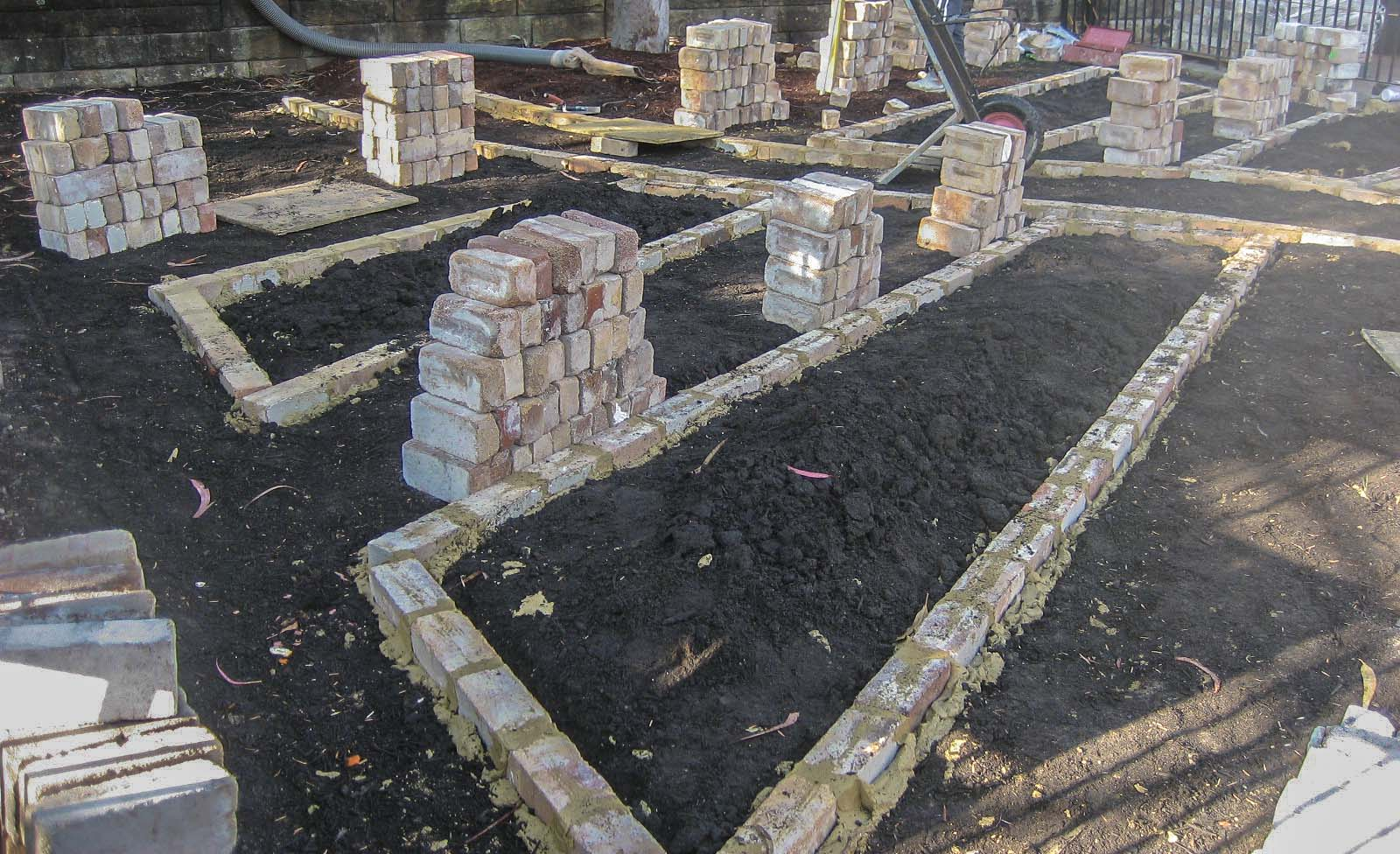 Construction of the recycled brick beds begins