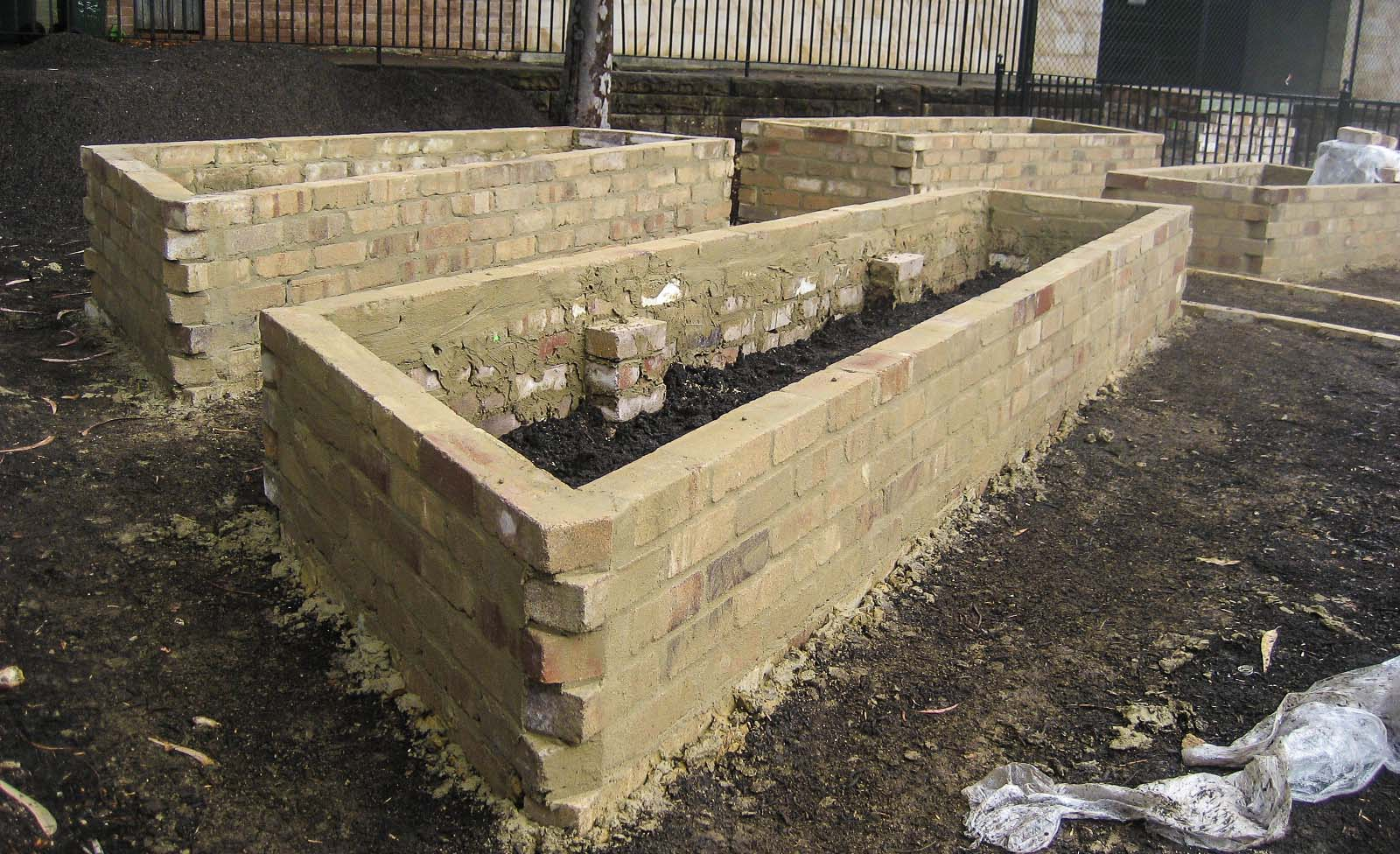 Recycled brick garden beds completed