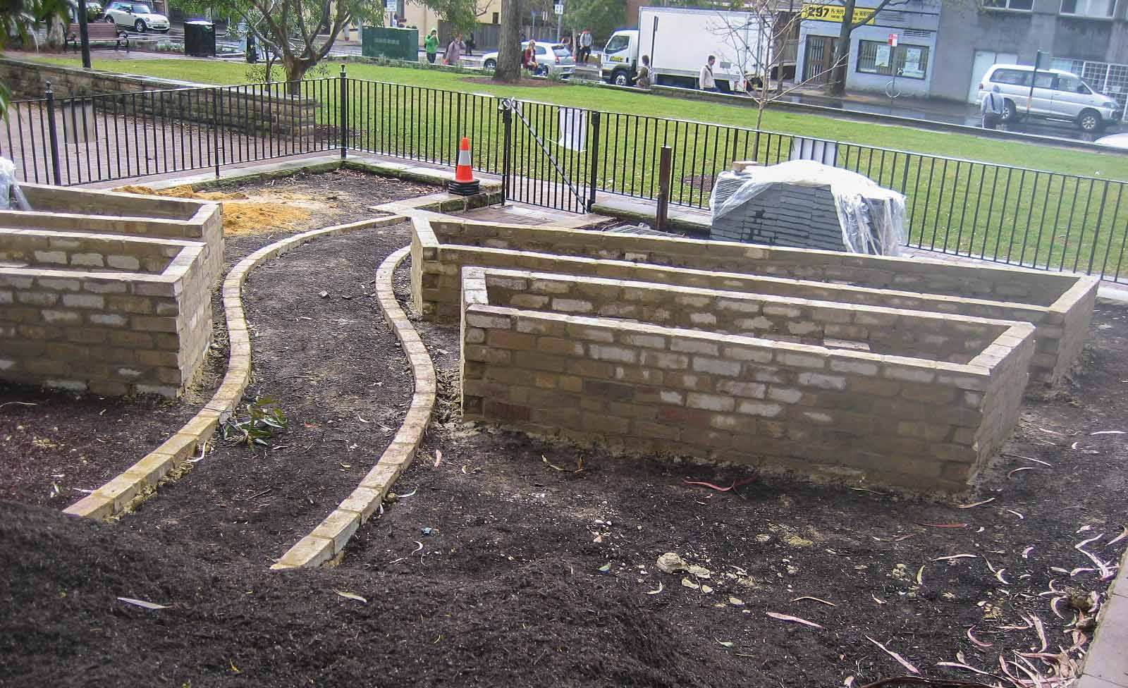 Path and beds in place, waiting for plants!